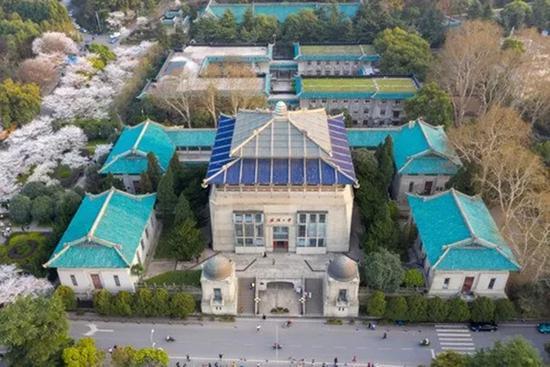 航拍武大行政楼周边樱花绽放风景.