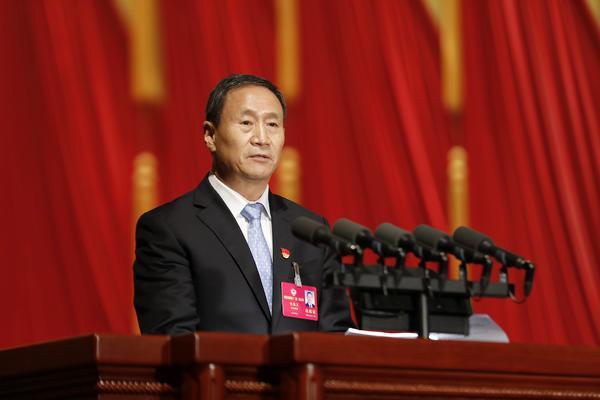 省政协副主席钱国玉作报告。