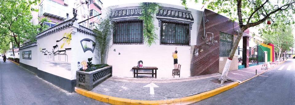 郑州老城街头的墙藏着山情水意